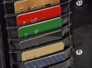Credit Cards in black wallet multicolored red green black blue gold.
